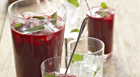 This Mixed Berry Cocktail With Ginger Syrup, Dark Rum & Mint is deliciously refreshing.