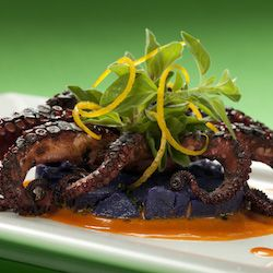 Florida Orange Braised Octopus With Purple Potato Salad And Pequillo Pepper Vinaigrette