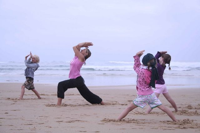 Kinder Yoga put on by WaveTours in Seignosse, France, for the summer season. www.downdogboutique.com