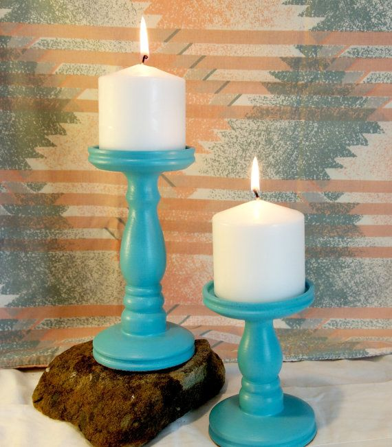 Make your home GLOW and SHIMMER with this set of two turquoise pillar candlesticks. This set made for pillar candles are 5 and 7 inches tall.