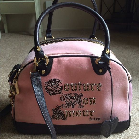 ✨JUICY Couture TeaCupPup Carrier✨ NWOT!! Never used! Super Rare to get a hold of these days! A Classic find!! Especially at this price! Some tiny minor flaws (pictured) The brown spots I think are from sitting in my garage. Fits small breeds like yorkie, Maltese, chihuahua and Shih tzu!!! Price is FIRM! No Trades! If you need more pics please let me know! Juicy Couture Bags Travel Bags