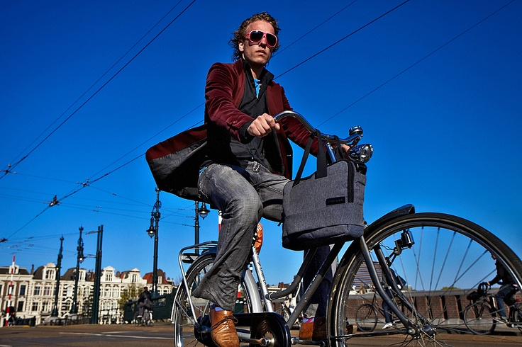 Early urban traffic. Click on the picture above to see more Amsterdam bikers!