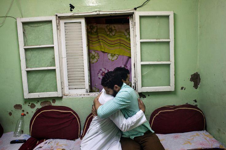 Paolo Pellegrin. EGYPT. Abdul Rahman and Mohamed Samir hug after praying in Sheik Abdul Rahman Toghian house. Mansoura. 2014