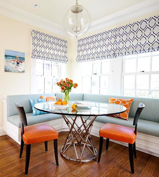 Blue and orange breakfast nook, benches, glass ball pendant light, glass table, navy and grey roman blind