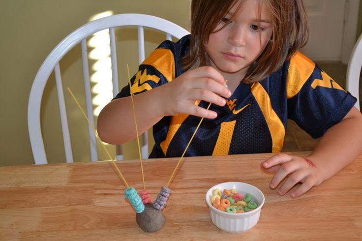 Playdough, Spaghetti noodles and cereal.  Good fine motor activity for preschoolers