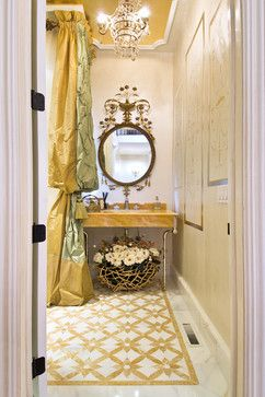 Details galore & an unusual color scheme in this romantic bathroom. Onyx and Calcutta (?) marble mosaic floor, onyx vanity with beautiful polished nickel legs, elaborate silk taffeta drapery panel, crystal chandelier, onyx-colored painted ceiling and over-the-top mirror make this room sparkle. www.sophiakhome.com