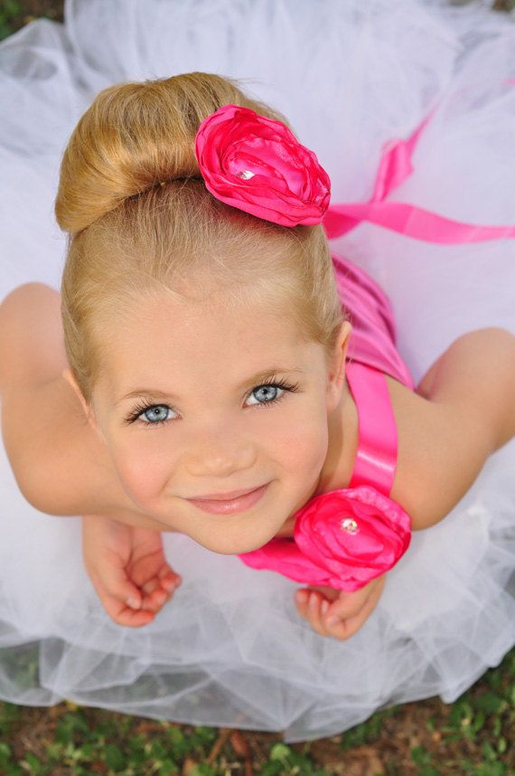 white tutu with hot pink or fuschia top, ribbons and flowers We like the flower in the hair!