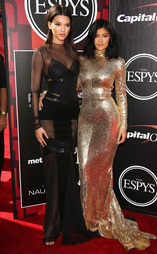 Kendall & Kylie Jenner from 2015 ESPY Awards Red Carpet Arrivals  Sister act! The Jenner girls are ultra-glam as always, with Kendall in a sexy black Alexandre Vauthier gown and Kylie in a tight gold Shady Zeineldine number.
