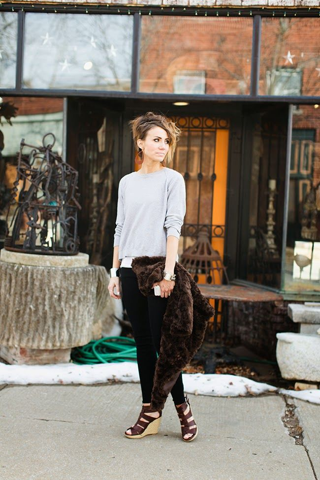 Casual Early Spring Date Outfit. Neutral tee and pants with fur jacket and wedges.