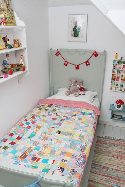 Lovely quilt in kids room surrounded by whimsical Safari Ltd. farm animals and horses.