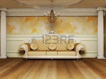 cielo raso: se trata de un interior antiguo con un hermoso sofá y las columnas