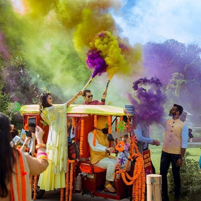 WEBSTA @ wedmegood - While I'm on vacation( see insta story) , I keep seeing the prettiest colours in corner cafes with hues of lime and lavender . Reminded me of crazy colourful mehendi entry on the wmg blog ! Click link in bio . Planned by @theweddingplanningcompany photography by @candidtales #smokebomb #color #indianbride #mehendi #indianwedding #wedding #colors #entry #love #beautiful