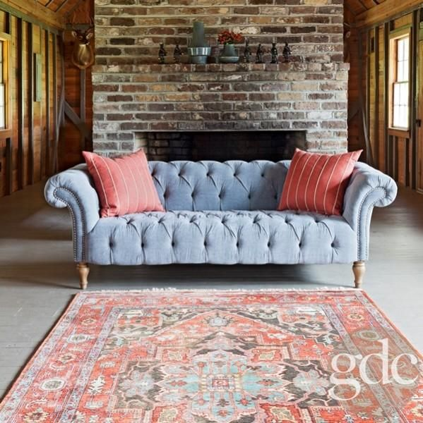 Faded blues and reds.  I love the fresh look of the light blue sofa.