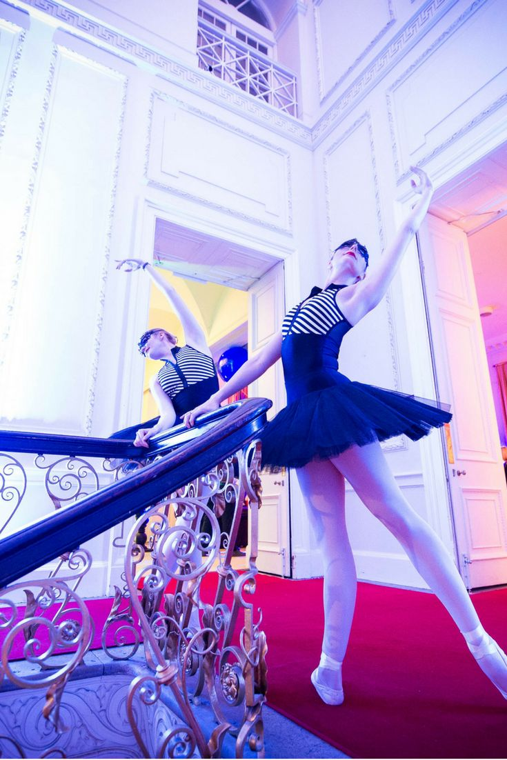 Ballet dancers strike a pose at the top of our gorgeous staircase - love the black and white tutu and dramatic eye masks