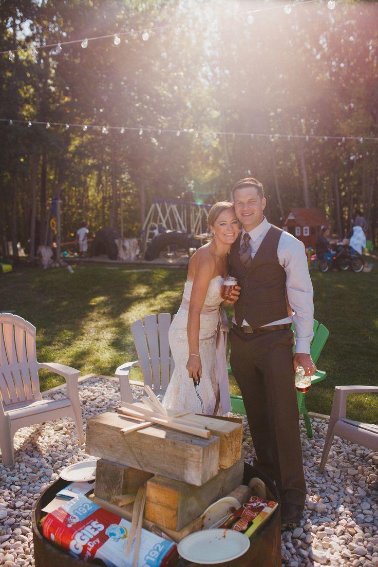 Lighting a bonfire instead of cutting a cake. Family, backyard wedding near Sherwood Park, Alberta. #chelsdawnphoto