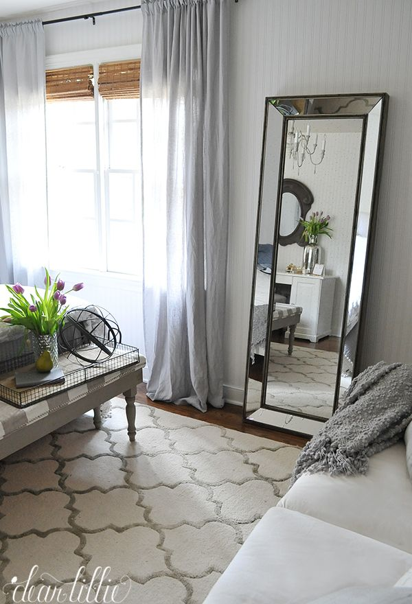 This tall standing mirror from HomeGoods is a great accent piece for this gray and white guest bedroom. And guests will love having a full length mirror in their room while they are visiting. (Sponsored pin)
