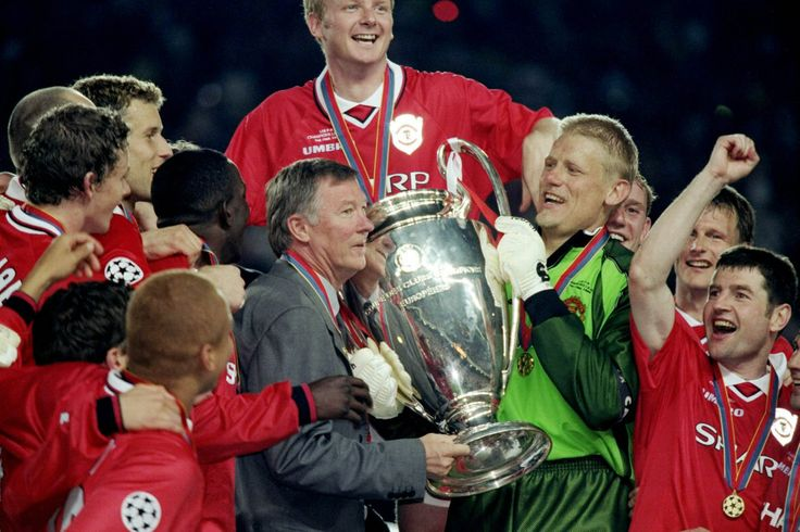 Manchester United manager Alex Ferguson and keeper Peter Schmeichel with the trophy after a 2-1 victory over Bayern Munich