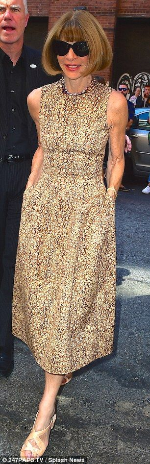 Flower power: Vogue editor-in-chief Anna Wintour made a chic arrival in a patterned dress and her signature large, designer shades