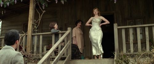 The Dressmaker (2015) - Sarah Snook as Gertrude Pratt wearing a champagne satin strapless dress with sweetheart neckline draped bodice and floral appliqués.  The costumes were designed by Marion Boyce.