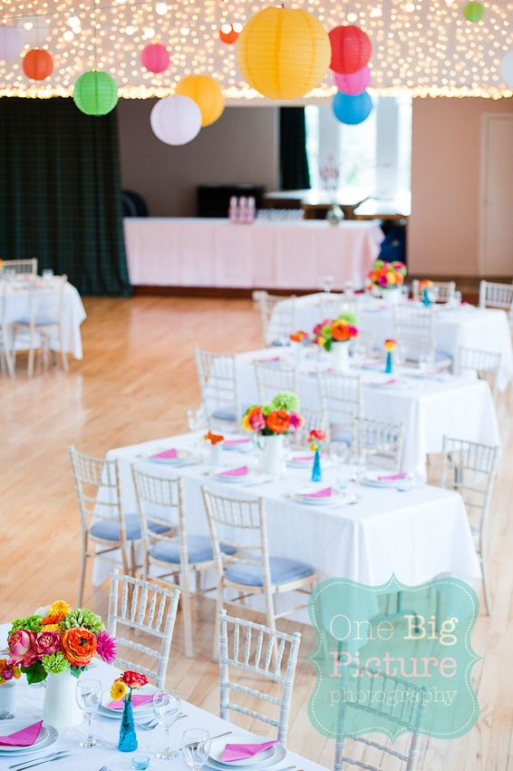Wish I could get married again just so it could be here!  @Mary Thompson Sisters Bake room layout for a wedding. Bright wedding flowers, colourful wedding flowers, bright wedding table setup, paper lanterns wedding. Photography by www.onebigpicture.co.uk