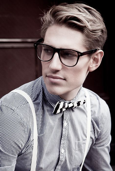 Hipster with a bow-tie, shirt and glasses.