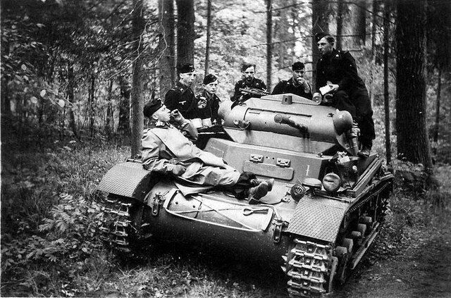 A Panzer II Ausf. A crew taking a break in the action.