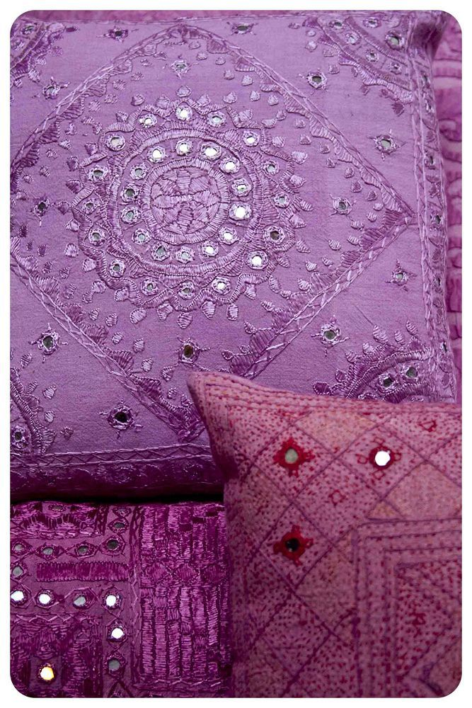 Radiant Orchid embroidered pillow case with a subtle raspberry and fuchsia shown in small proportions.