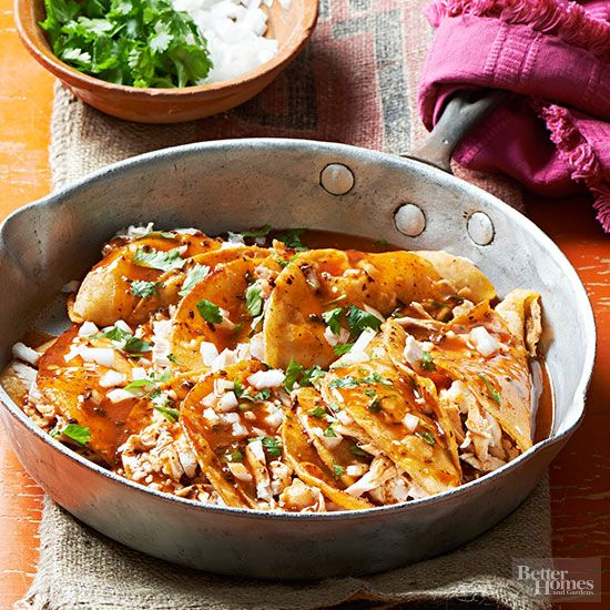 Spicy red sauce sweetened with honey coats corn tortillas in this delicious homemade take on food-truck enchiladas. Shredded chicken and crumbled queso fresco provide the finger-licking filling, while chopped onions contribute crunch./