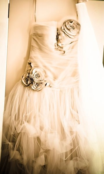Weddings call for adorning accents like thee roses on this wedding dress