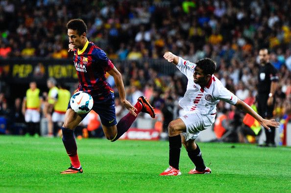 Neymar of FC Barcelona duels for the ball with Jorge Andujar Moreno 'Coke' of Sevilla FC during the La Liga match between FC Barcelona and Sevilla FC at Camp Nou on September 14, 2013 in Barcelona, Catalonia.