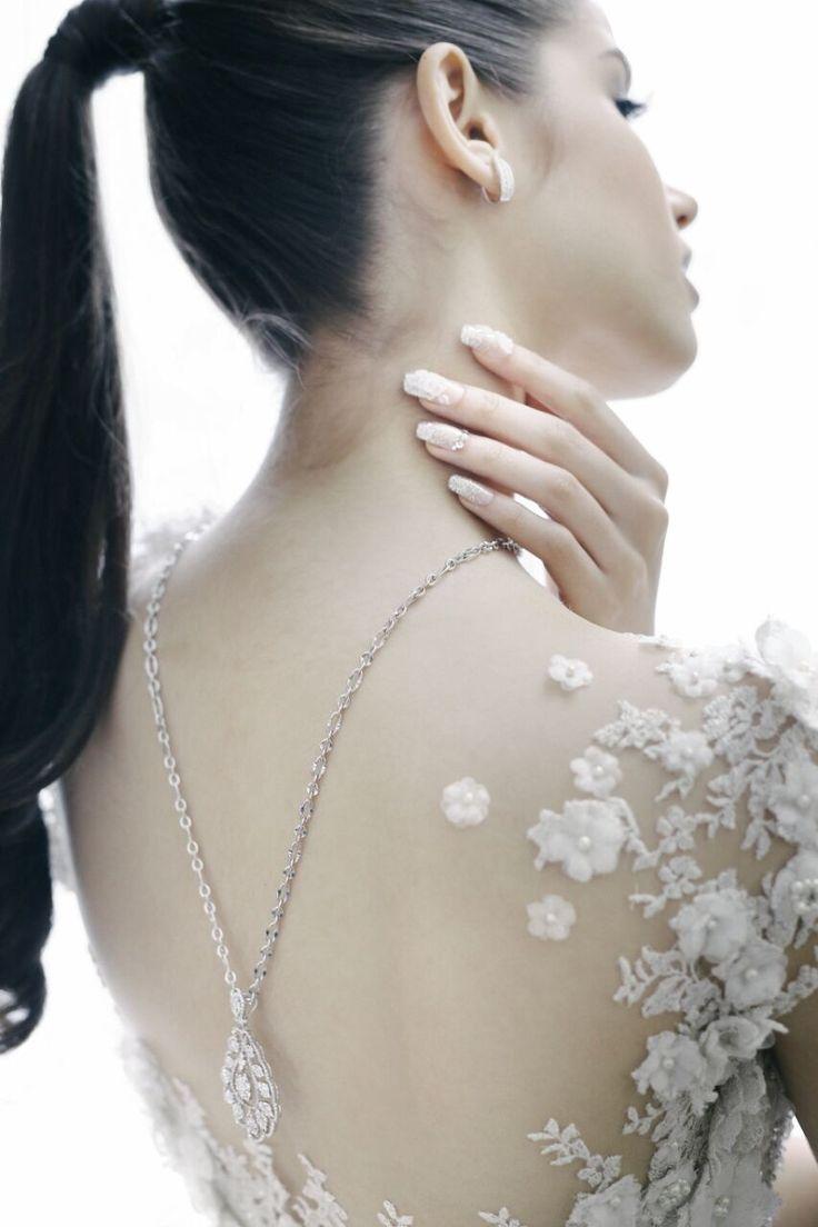 Wedding dress back detail by Oscar Daniel