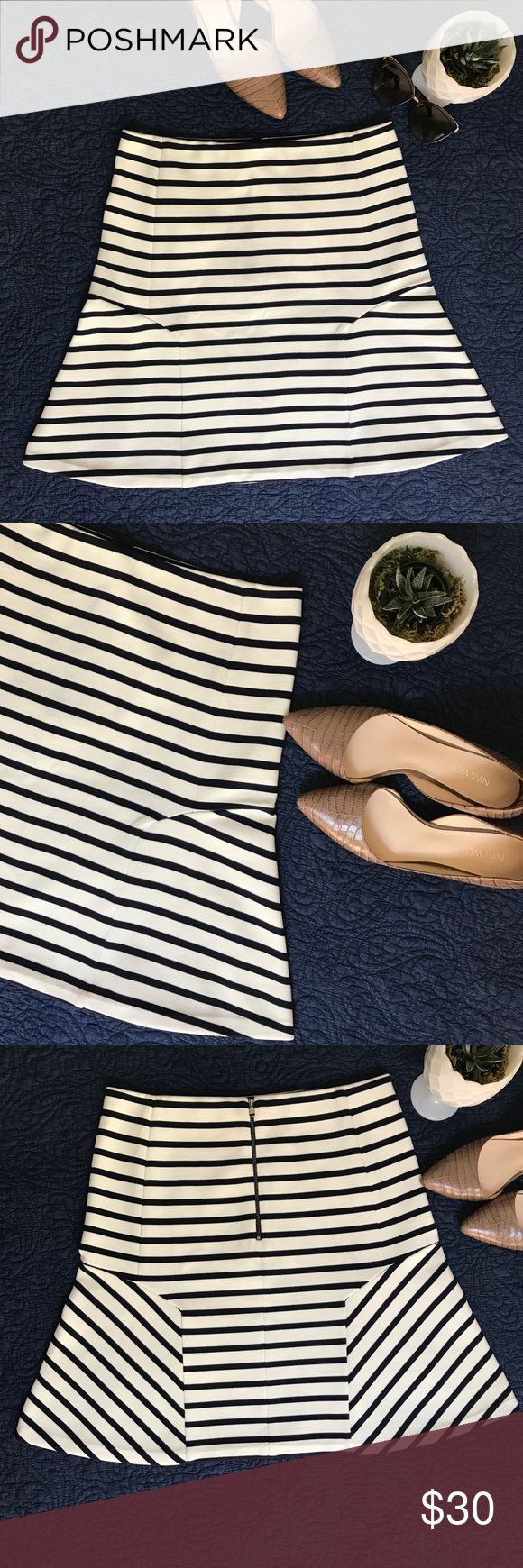 Ann Taylor Flared White & Navy Striped Skirt Ann Taylor Flared White & Navy Striped Skirt. Like new! Size 8 Fits true to size (fabric has some stretch). Very flattering on the hips! Perfect for any occasion! ⛵️ can be dressed up or down.                                                       *pet and smoke free home* Ann Taylor Skirts A-Line or Full