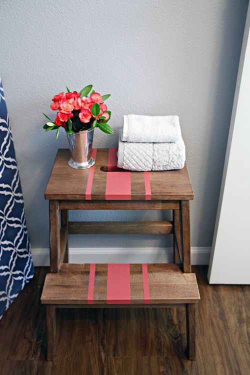 The BEKVAM step-stool is a double-duty bathroom organizer.