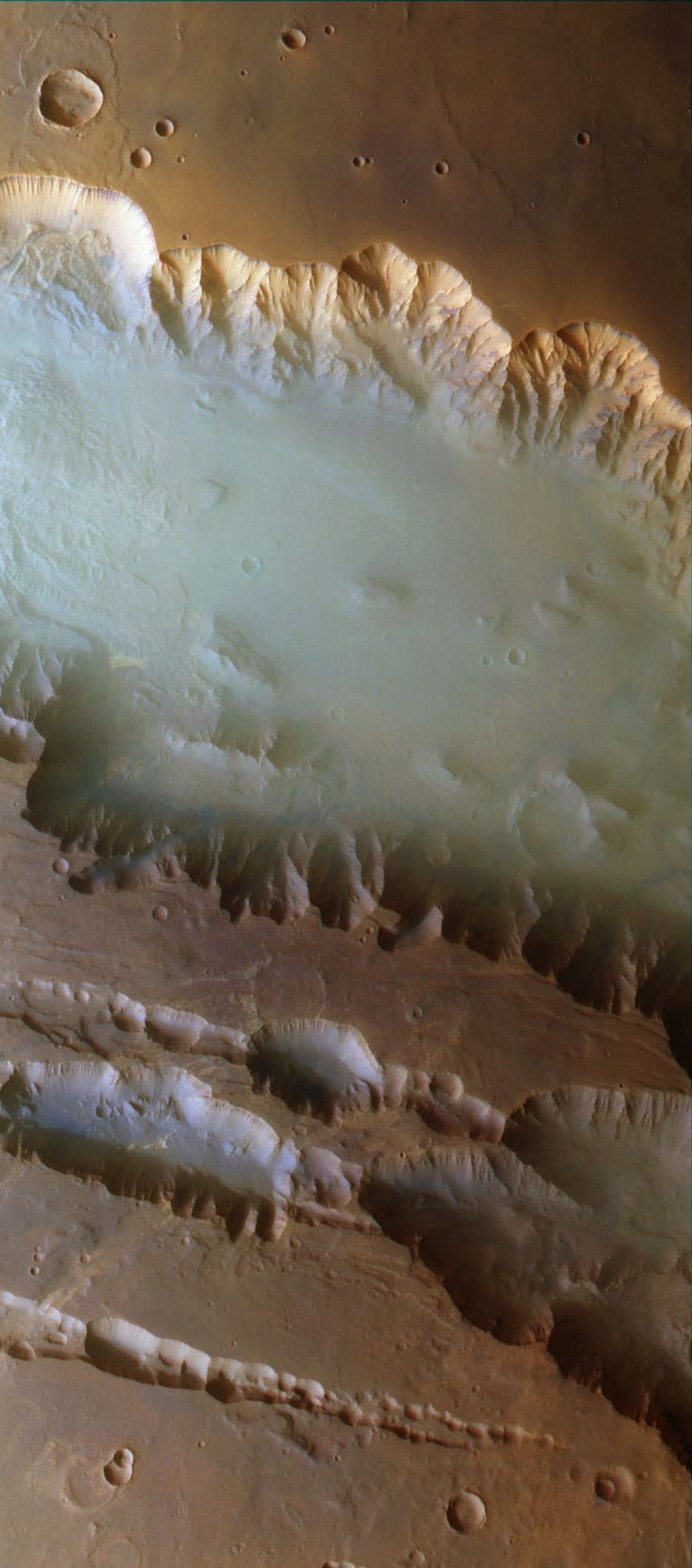 "Mist in the Canyon A mist of water ice crystals hangs in the ""Grand Canyon of Mars,"" Valles Marineris. Observed by the Mars Express orbiter. ESA / G. Neukum (Freie Universitaet, Berlin, Germany) / Bill Dunford"