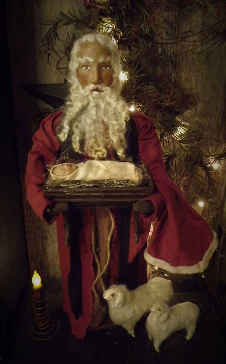 Paula B. Primitive Santa with baby Jesus