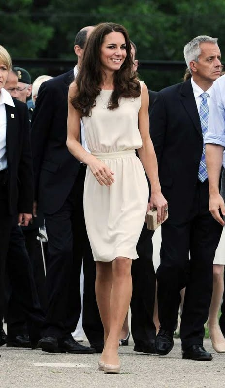 Classic Kate: cream cocktail dress floats on Kate's perfect figure. Her complexion compliments this color perfectly.