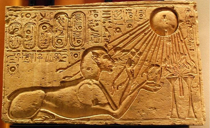 Akhenaten depicted as a sphinx at Amarna, solar rays bathing him.