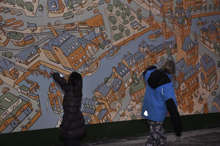 My mural is inspected by local kids.