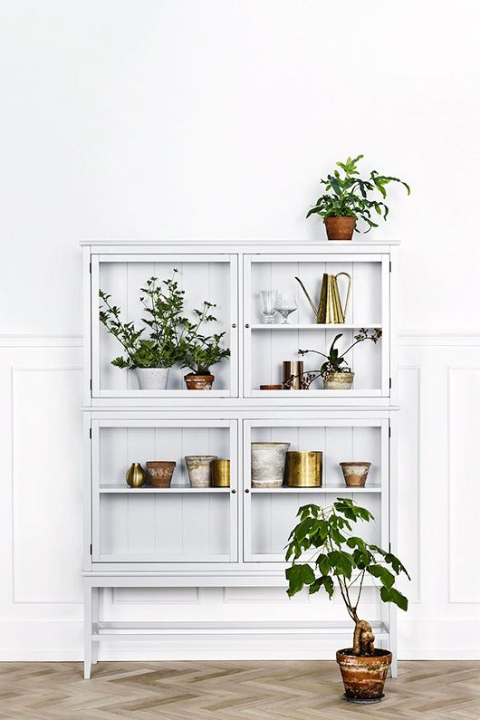 white cabinet with pottery and plants / sfgirlbybay