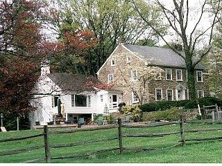 Pennsylvania stone farmhouse with wooden addition.