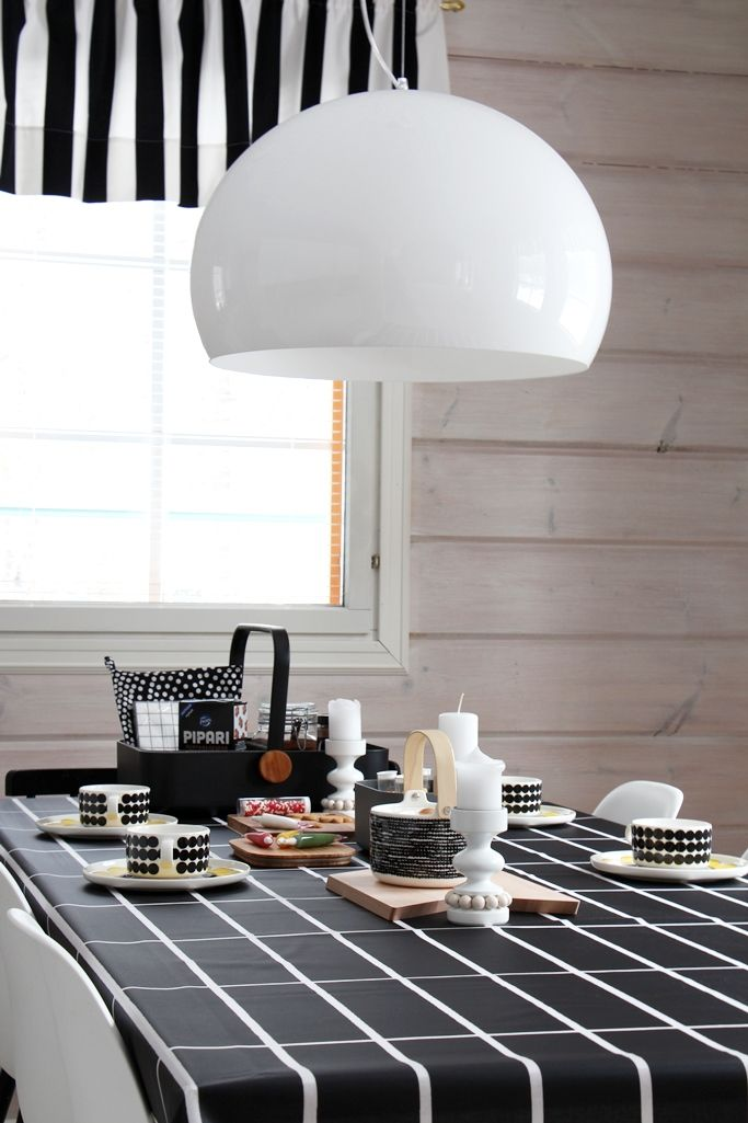 Gorgeous monochrome table setting with siirtolapuutarha ceramics, perfect dining.