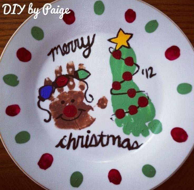 Customize Santa plates with hand and footprints.
