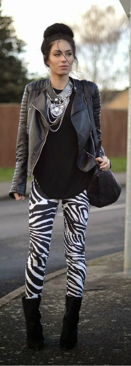 Zebra prints leggings with statement necklace and leather coat.