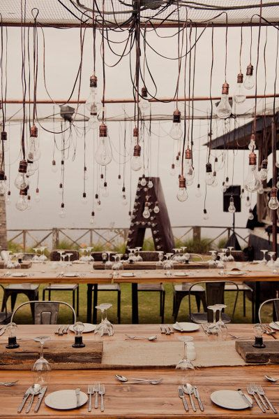 tables outfitted with a sea of edison bulbs