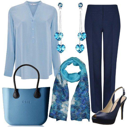 Colori+delicati+e+tessuti+morbidi+per+la+proposta+dedicata+alla+donna+a+cui+piace+essere+legante+in+ogni+occasione+,+anche+al+lavoro.+Un+paio+di+pantaloni+blu+si+abbinano+ad+una+camicia+in+viscosa+celeste.+Le+scarpe+sono+dei+sandali+spuntati+con+tacco+altissimo.+Un+delicato+foulard+e+un+paio+di+orecchini+con+pendenti+a+forma+di+cuore+completano+la+composizione.