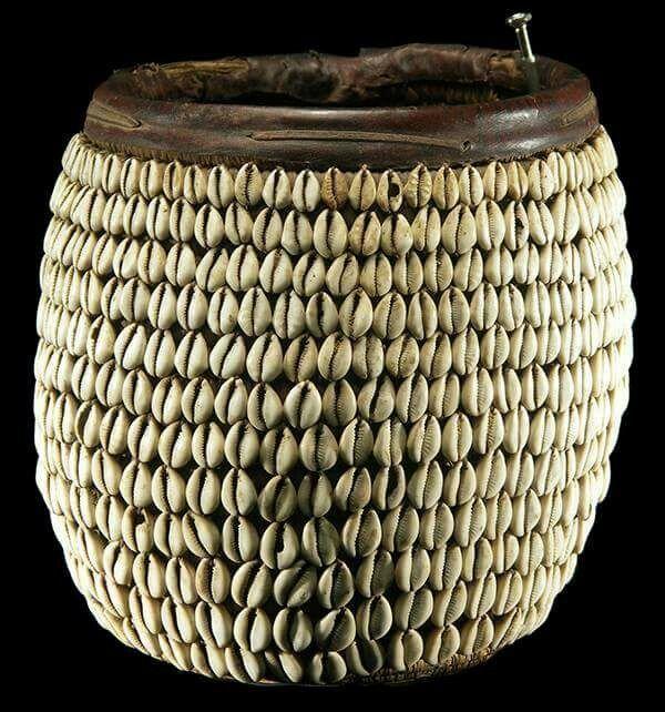 Cowrie-studded basket from Ghana or Ivory Coast.