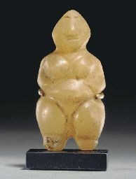 A WESTERN ASIATIC ALABASTER STEATOPYGOUS FIGURE