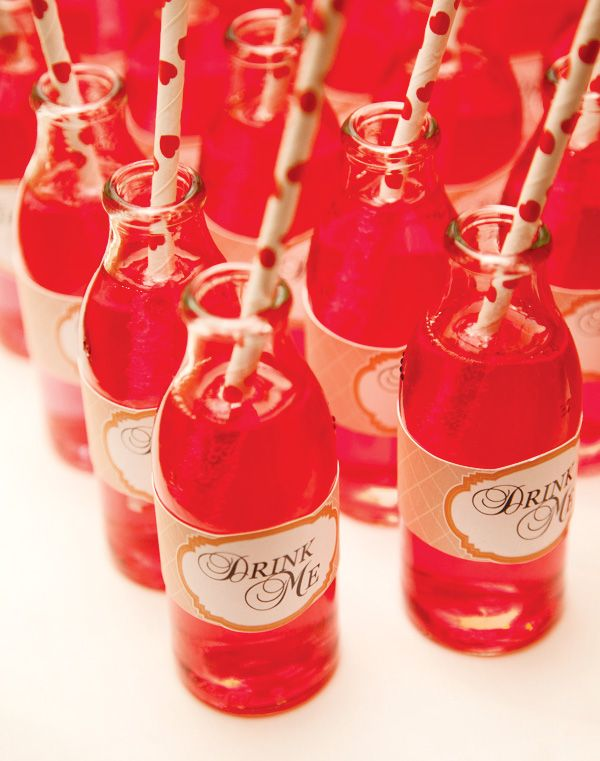 """""""Drink Me"""" labels for drinks at an Alice in Wonderland themed baby shower."""