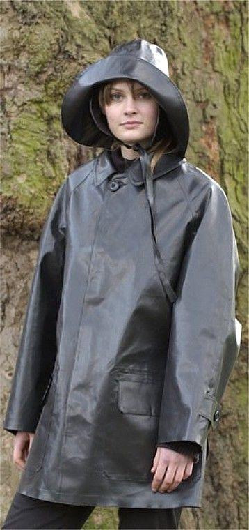 Lady in heavy-duty black rubber rainwear.