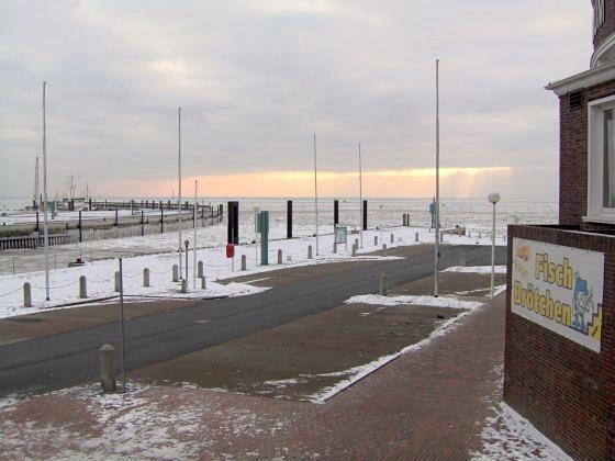 Frozen North Sea, Wilhelmshaven, Helgoland Pier, Germany.